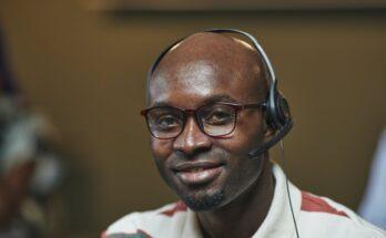 man in white shirt wearing black headphones