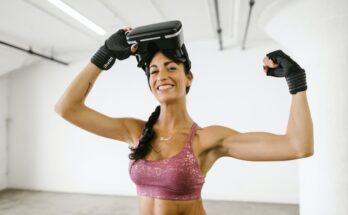 a fit woman in a pink sports bra wearing vr goggles